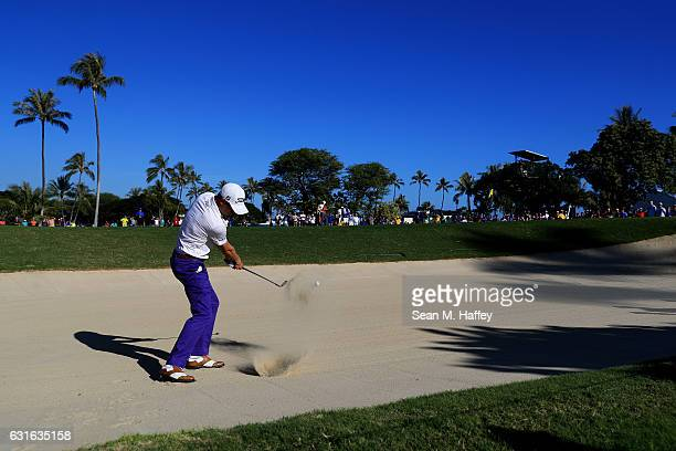 Justin Thomas of the United States plays a shot from a bunker on the 13th hole during the second round of the Sony Open In Hawaii at Waialae Country...