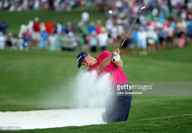 Justin Thomas of the United States plays a shot from a bunker on the 18th hole during the final round of the 2017 PGA Championship at Quail Hollow...