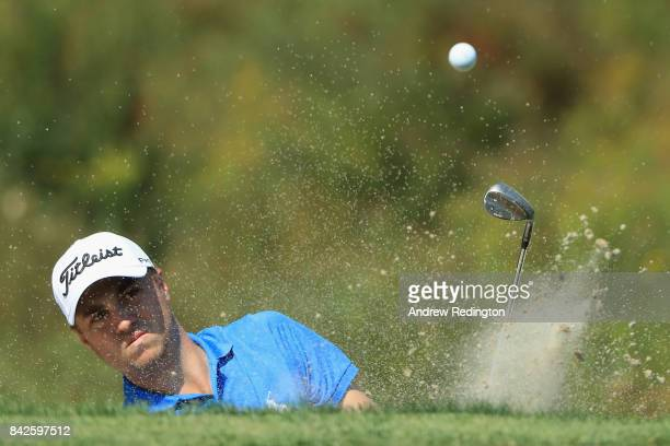 Justin Thomas of the United States plays a shot from a bunker on the third hole during the final round of the Dell Technologies Championship at TPC...