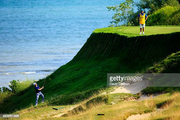Justin Thomas of the United States plays a shot on the 17th hole during the first round of the 2015 PGA Championship at Whistling Straits on August...