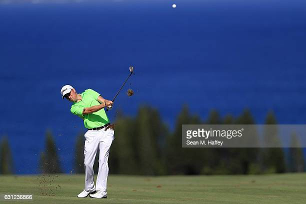 Justin Thomas of the United States plays a shot on the fourth hole during the final round of the SBS Tournament of Champions at the Plantation Course...