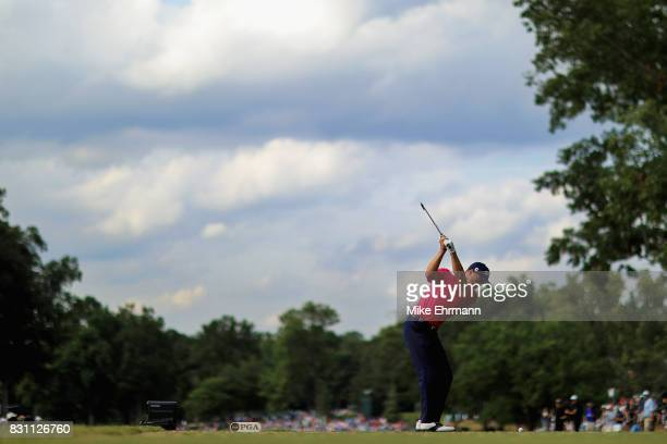 Justin Thomas of the United States plays his shot from the 14th tee during the final round of the 2017 PGA Championship at Quail Hollow Club on...