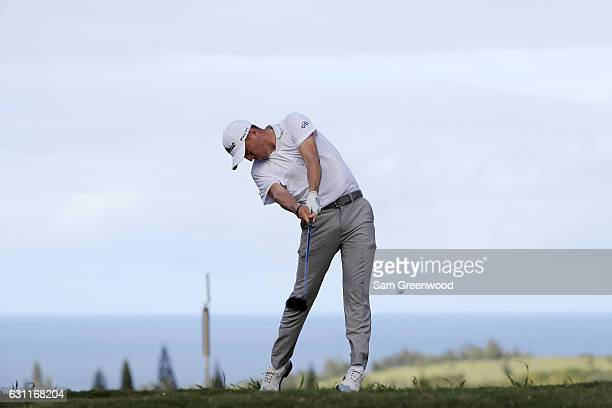 Justin Thomas of the United States plays his shot from the 16th tee during the third round of the SBS Tournament of Champions at the Plantation...