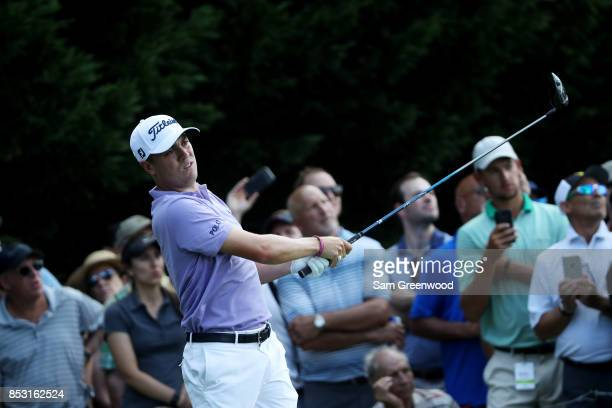 Justin Thomas of the United States plays his shot from the eighth tee during the final round of the TOUR Championship at East Lake Golf Club on...