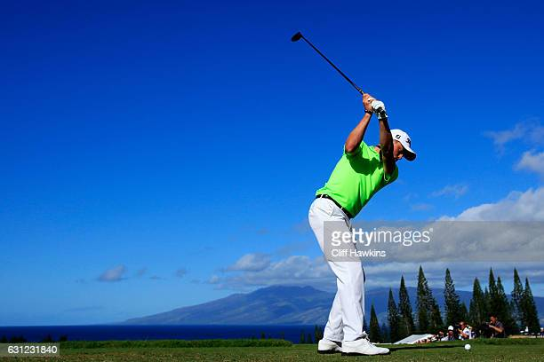 Justin Thomas of the United States plays his shot from the first tee during the final round of the SBS Tournament of Champions at the Plantation...