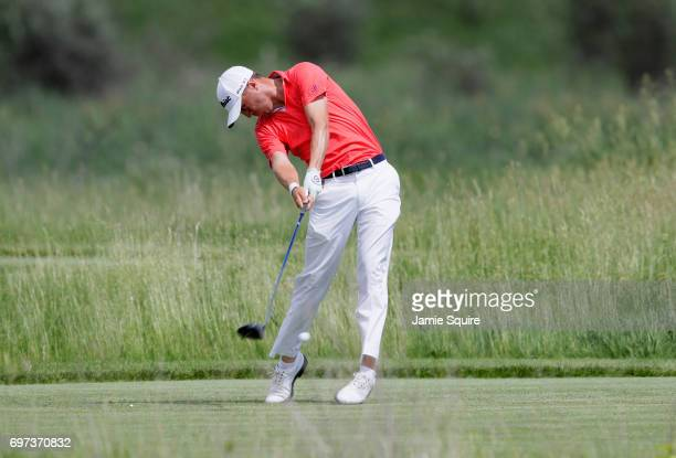 Justin Thomas of the United States plays his shot from the second tee during the final round of the 2017 US Open at Erin Hills on June 18 2017 in...