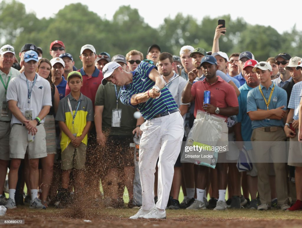 Justin Thomas of the United States plays his shot on the 16th hole during the third round of the 2017 PGA Championship at Quail Hollow Club on August 12, 2017 in Charlotte, North Carolina.