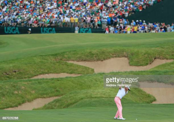Justin Thomas of the United States plays his shot on the 18th hole during the third round of the 2017 US Open at Erin Hills on June 17 2017 in...