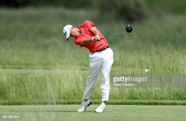 Justin Thomas of the United States plays his tee shot at the par 4 second hole during the final round of the 117th US Open Championship at Erin Hills...