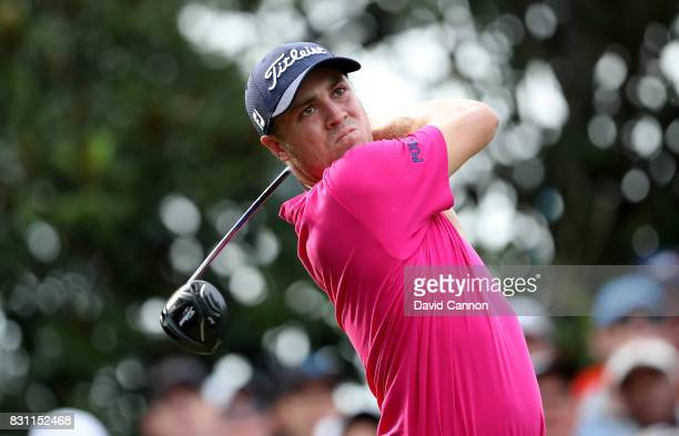 Justin Thomas of the United States plays his tee shot on the par 4 16th hole during the final round of the 2017 PGA Championship at Quail Hollow on...