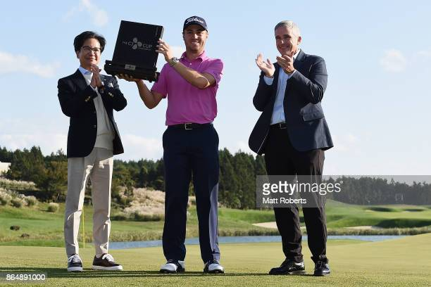 Justin Thomas of the United States poses with Lee Jay Hyun and Jay Monahan after winning the CJ Cup at Nine Bridges on October 22 2017 in Jeju South...