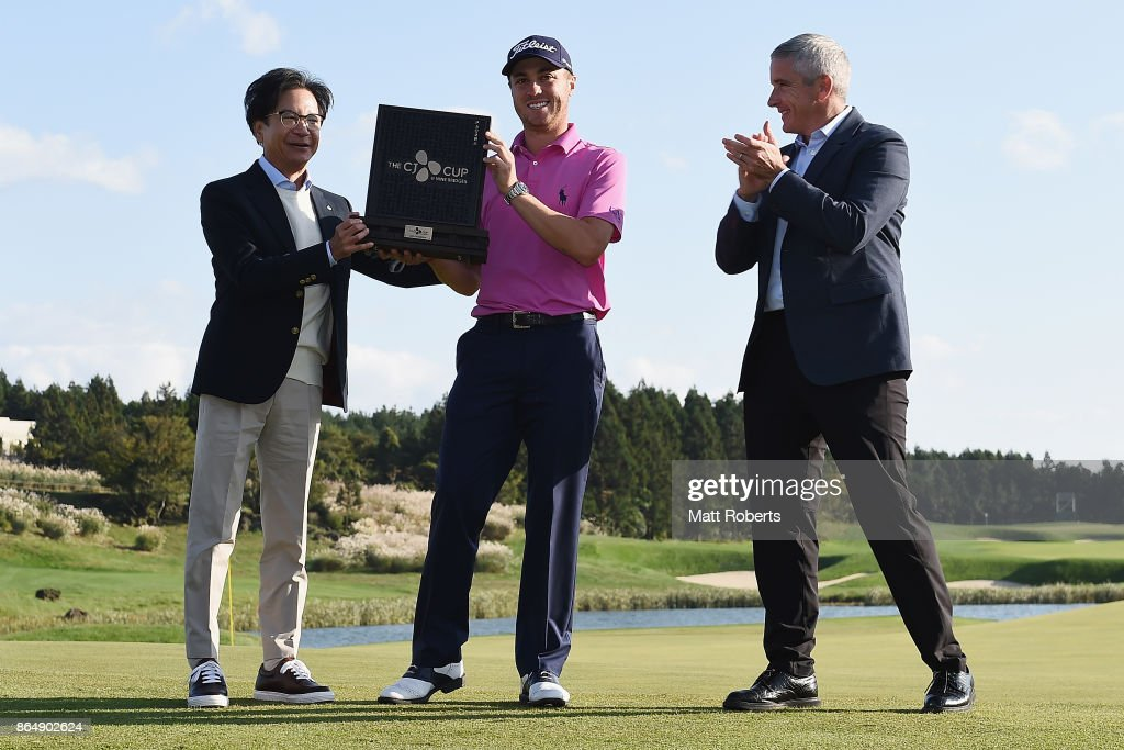 Justin Thomas (C) of the United States poses with Lee Jay Hyun (L) and Jay Monahan (R) after winning the CJ Cup at Nine Bridges on October 22, 2017 in Jeju, South Korea.