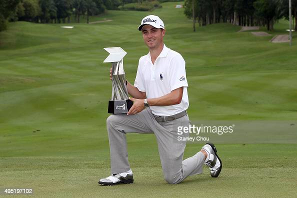 Justin Thomas of the United States poses with the CIMB Classic Trophy after he won it by 26 under 262 during round four of the CIMB Classic at Kuala...