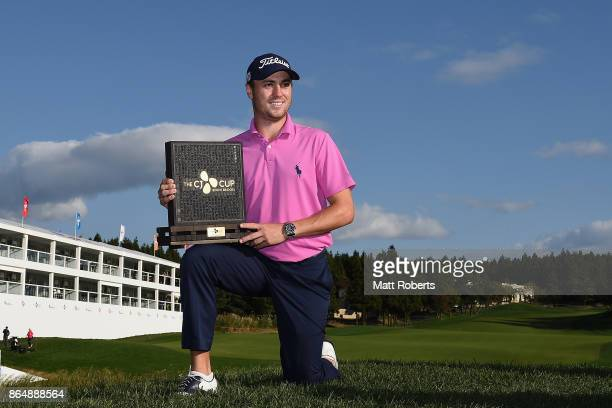Justin Thomas of the United States poses with the trophy after winning the CJ Cup at Nine Bridges on October 22 2017 in Jeju South Korea