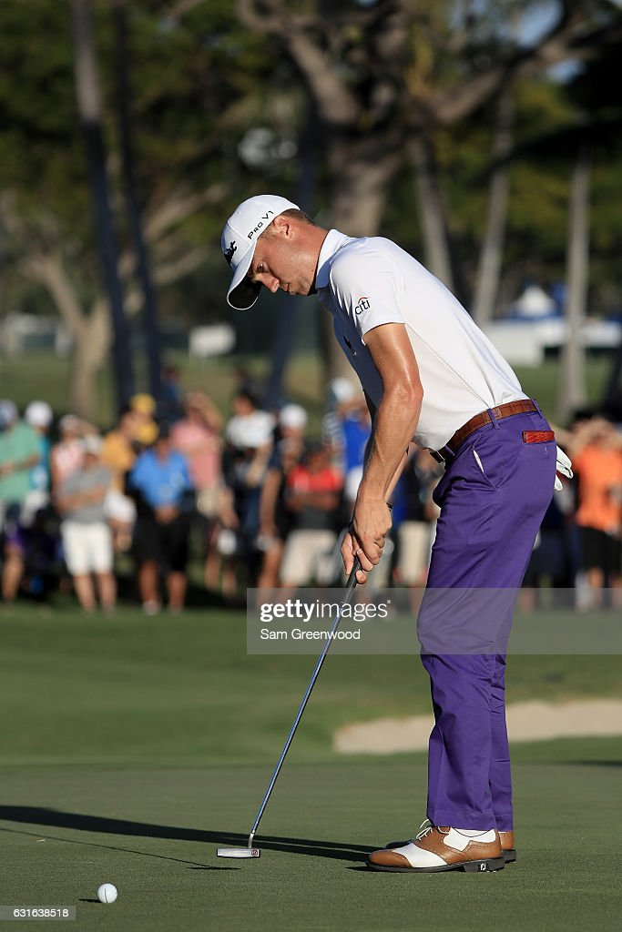 Justin Thomas of the United States putts for eagle on the 18th green during the second round of the Sony Open In Hawaii at Waialae Country Club on January 13, 2017 in Honolulu, Hawaii.