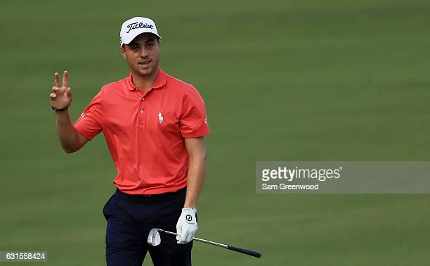 Justin Thomas of the United States reacts after chpping in on the tenth hole during the first round of the Sony Open In Hawaii at Waialae Country...