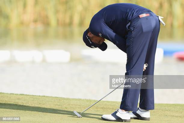 Justin Thomas of the United States reacts after his putt on the 18th green during the final round of the CJ Cup at Nine Bridges on October 22 2017 in...