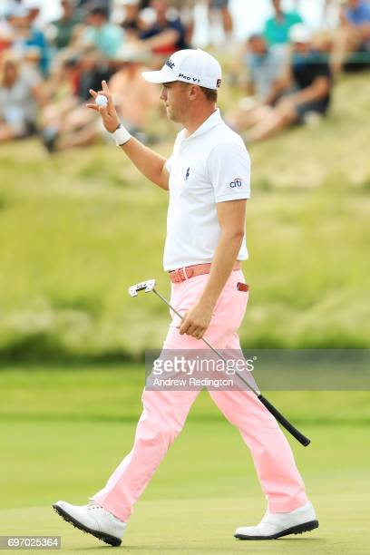 Justin Thomas of the United States reacts after making a birdie on the 17th green during the third round of the 2017 US Open at Erin Hills on June 17...