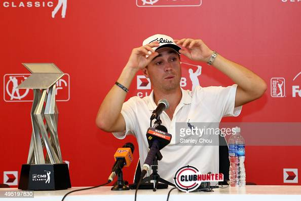 Justin Thomas of the United States reacts at the post tournament press conference after he won by 26 under 262 during round four of the CIMB Classic...
