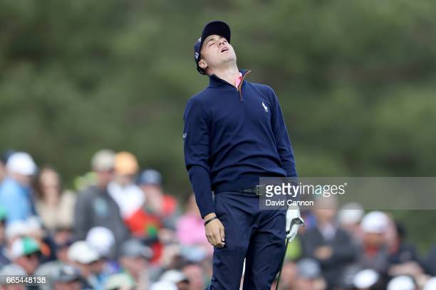 Justin Thomas of the United States reacts on the 12th hole during the first round of the 2017 Masters Tournament at Augusta National Golf Club on...