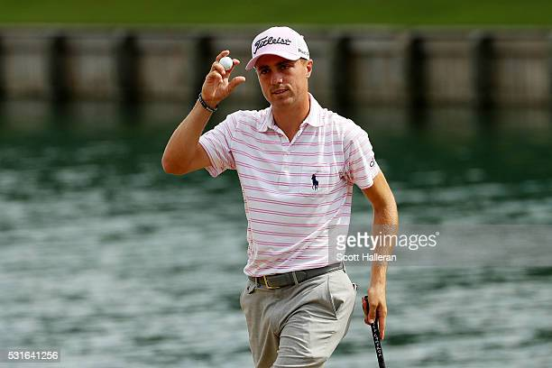 Justin Thomas of the United States reacts on the 18th green after finishing seven under for the day with a 65 during the final round of THE PLAYERS...