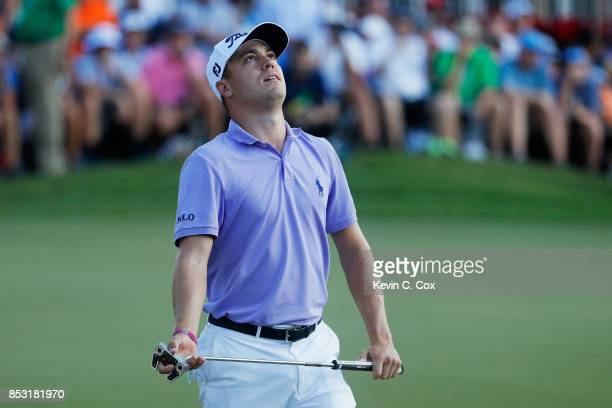 Justin Thomas of the United States reacts to a missed birdie putt on the 18th green on his way to winning the FedExCup and second in the TOUR...