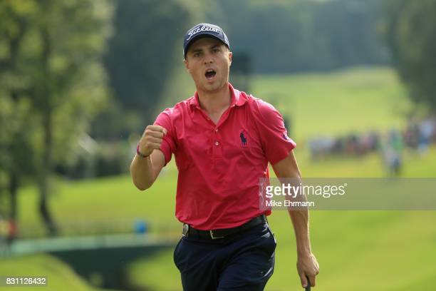 Justin Thomas of the United States reacts to his birdie putt on the 13th green during the final round of the 2017 PGA Championship at Quail Hollow...