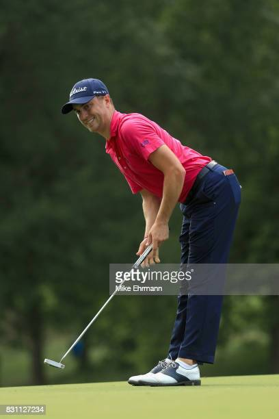 Justin Thomas of the United States reacts to his putt on the 12th green during the final round of the 2017 PGA Championship at Quail Hollow Club on...