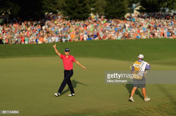 Justin Thomas of the United States reacts to his putt on the 18th green with an 8 finish during the final round of the 2017 PGA Championship at Quail...