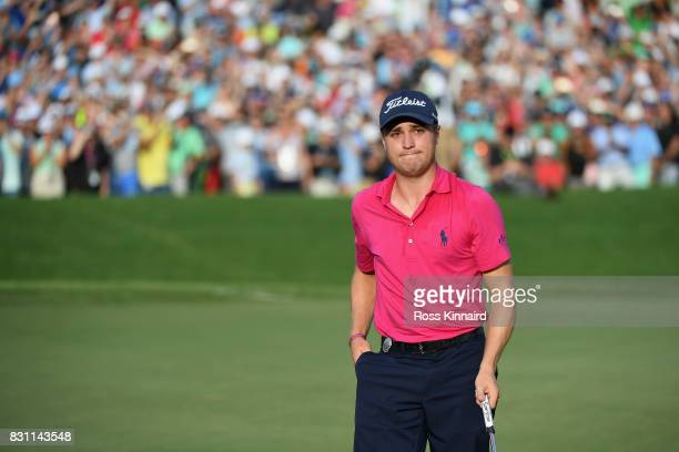 Justin Thomas of the United States reacts to his putt on the on the 18th green during the final round of the 2017 PGA Championship at Quail Hollow...