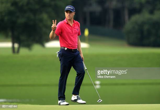 Justin Thomas of the United States reacts to his putt on the on the 17th green during the final round of the 2017 PGA Championship at Quail Hollow...