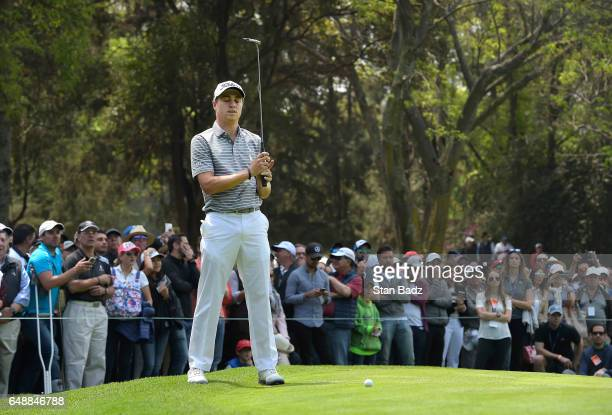 Justin Thomas of the United States reacts to his putt on the second hole during the final round of the World Golf ChampionshipsMexico Championship at...