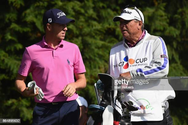 Justin Thomas of the United States speaks with his caddie during the final round of the CJ Cup at Nine Bridges on October 22 2017 in Jeju South Korea