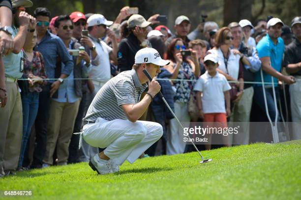 Justin Thomas of the United States studies his putt on the second hole during the final round of the World Golf ChampionshipsMexico Championship at...