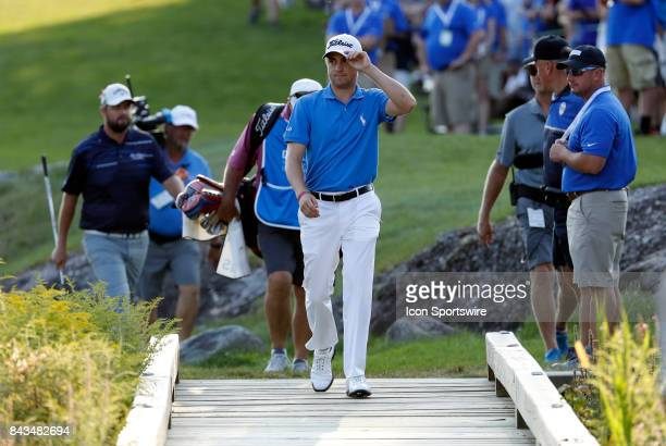 Justin Thomas of the United States tips his cap as he crosses the bridge to the green on 18 during the final round of the Dell Technologies...