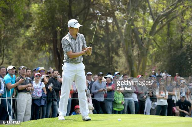 Justin Thomas of the United States watches his putt on the second hole during the final round of the World Golf ChampionshipsMexico Championship at...