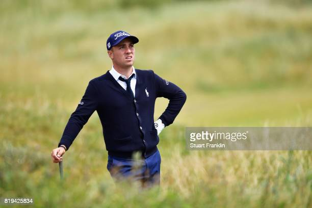 Justin Thomas of the United States watches his shot from the rough on the 16th hole during the first round of the 146th Open Championship at Royal...