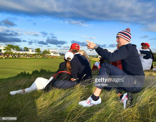 Justin Thomas of the United States watches play on the 17th hole during the afternoon fourball matches at the Presidents Cup at Liberty National Golf...