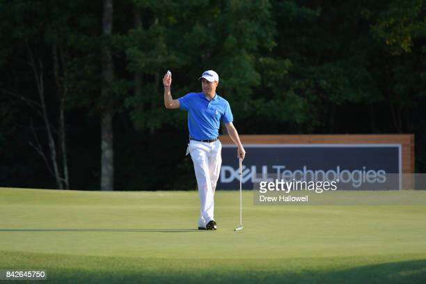 Justin Thomas of the United States waves to the crowd after making a putt for par on the 18th green to win the Dell Technologies Championship at TPC...