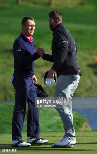 Justin Thomas of the US is congratulated by Marc Leishman of Australia after Thomas won the CJ Cup golf tournament at Nine Bridges in Jeju Island on...