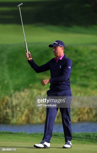 Justin Thomas of the US reacts after winning the CJ Cup golf tournament at Nine Bridges in Jeju Island on October 22 2017 Justin Thomas holed a...