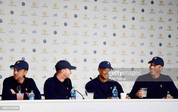 Justin Thomas of the US Team Daniel Berger of the US Team Tiger Woods Captains Assistant of the US Team and Matt Kuchar of the US Team speak to the...