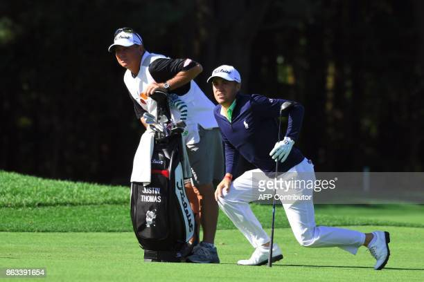 Justin Thomas of the US watches after his second shot on the third hole during the second round of the CJ Cup at Nine Bridges in Jeju Island on...