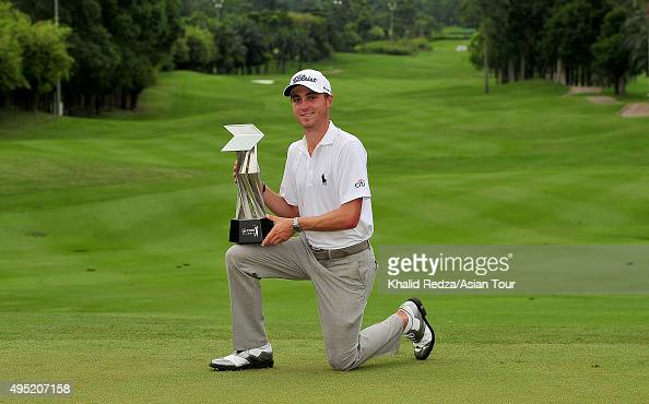 Justin Thomas of USA Posing With the trophy after winning the CIMB Classic at Kuala Lumpur Golf Country Club on November 1 2015 in Kuala Lumpur...
