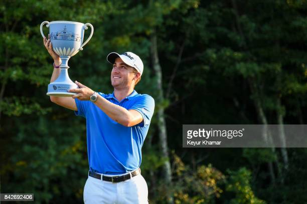 Justin Thomas raises the trophy following his three stroke victory in the final round of the Dell Technologies Championship at TPC Boston on...