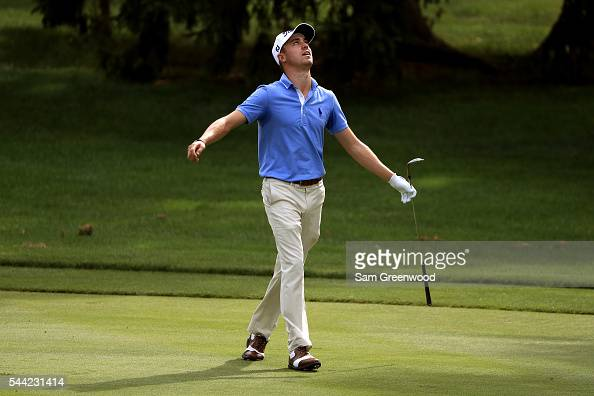 Justin Thomas reacts after a shot on the 16th hole during the third round of the World Golf Championships Bridgestone Invitational at Firestone...