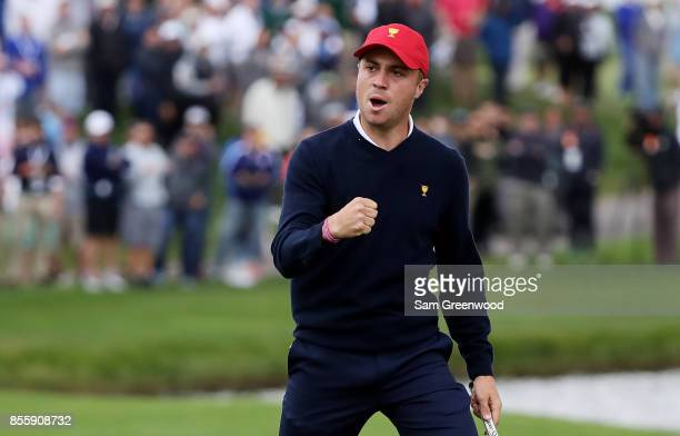 Justin Thomas reacts on the 18th green as he and Rickie Fowler of the US Team go halves with Branden Grace of South Africa and the International Team...