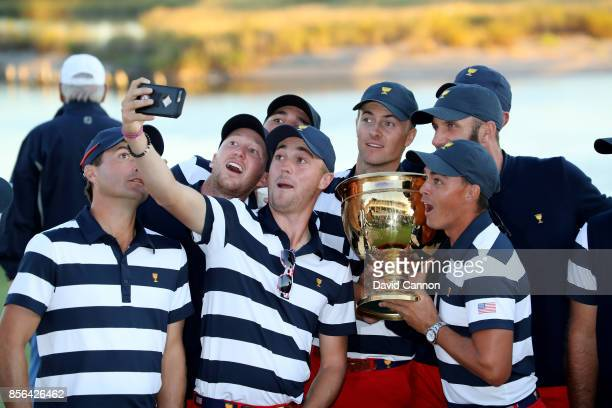 Justin Thomas Rickie Fowler Jordan Spieth and other members of the victorious United States team enjoy taking a 'selfie' with the Presidents Cup...