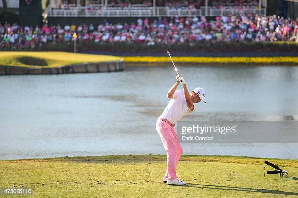 Justin Thomas tees off on the 17th hole island green during the final round of THE PLAYERS Championship on THE PLAYERS Stadium Course at TPC Sawgrass...