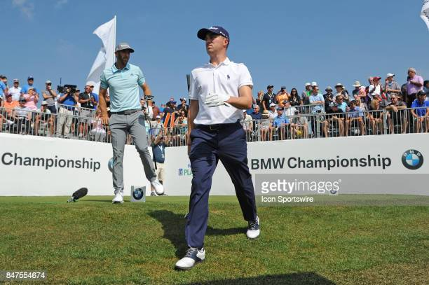 Justin Thomas walks off the tenth hole tee box in front of Dustin Johnson during the First Round of the BMW Championship on September 14 at Conway...